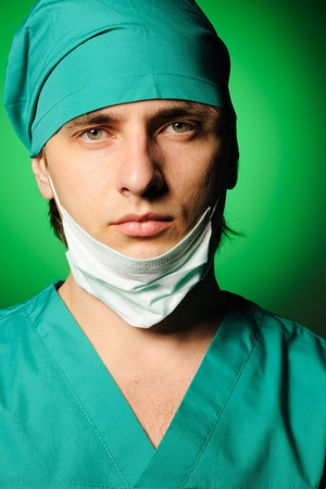 Surgeon with mask over green Stock Photo - 8392623