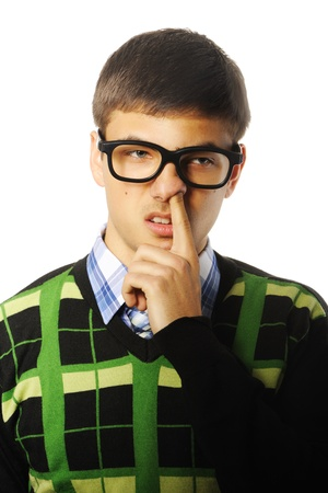 Young nerd student with finger in nose photo