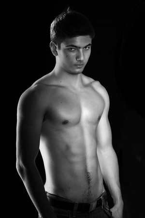 Man with muscular torso over black Stock Photo - 8621908