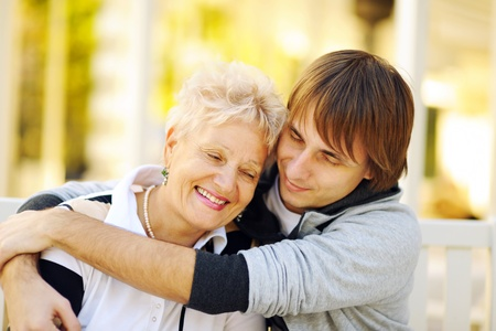 blonde mom: Mother and son having a hug Stock Photo