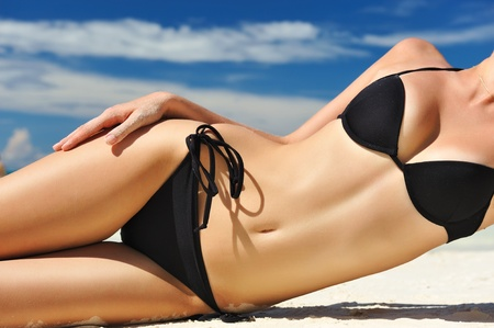 Woman with  beautiful body on a tropical beach Stock Photo - 8992630