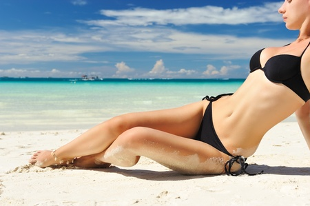 Woman with  beautiful body on a tropical beach Stock Photo - 8992627