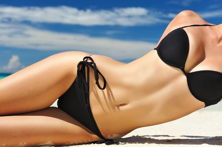beach breast: Woman with  beautiful body on a tropical beach
