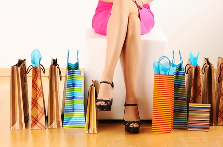 pouf: Womans legs and shopping bags  Stock Photo
