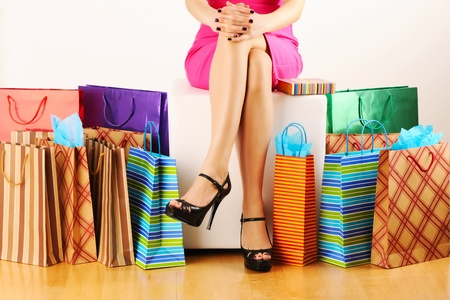 happy shopper: Womans legs and shopping bags  Stock Photo