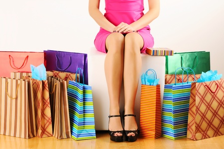 Womans legs and shopping bags  photo