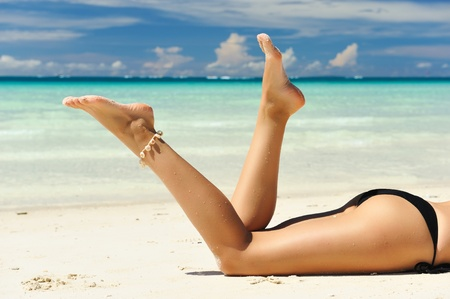 beautiful legs: Womens beautiful legs on the beach