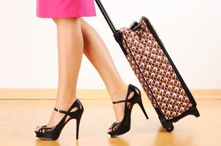 Woman's legs and travel suitcase Stock Photo - 9169622