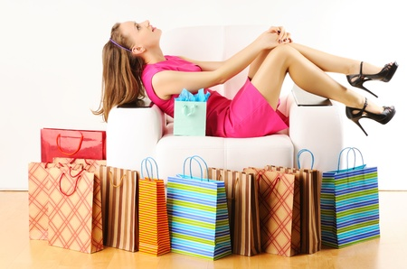 Woman with shopping bags having a rest on sofa Stock Photo - 9169633