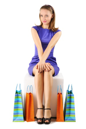 pouf: Woman with shopping bags isolated on white