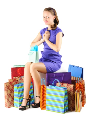 pouffe: Woman with shopping bags isolated on white