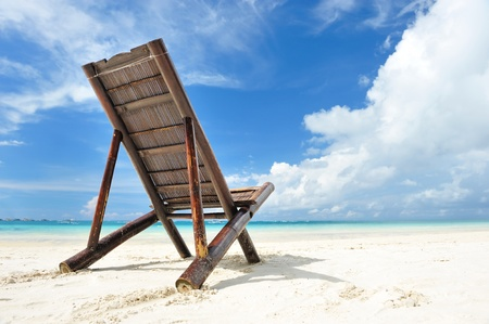 chaise lounge: Beautiful beach with chaise lounge Stock Photo