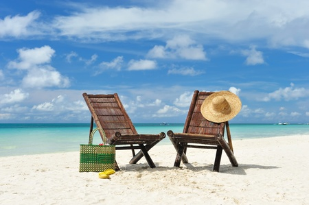 destination scenic: Beautiful beach with chaise lounge Stock Photo
