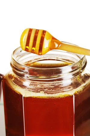 Jar of honey and dipper Stock Photo - 9213358