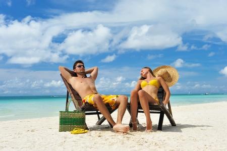 woman sandals: Couple on a tropical beach