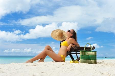 Girl on a tropical beach photo