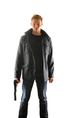silencer: Man holding gun with silencer over white