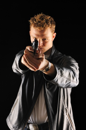 Man holding gun with over black photo