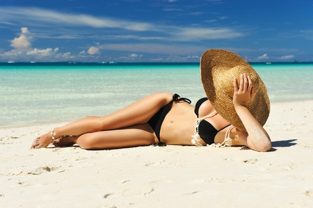 beach hat: Girl on a tropical beach with hat Stock Photo