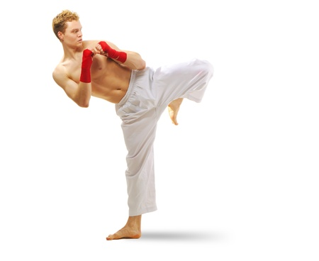 pectoral muscle: Man training martial arts Isolated on white background