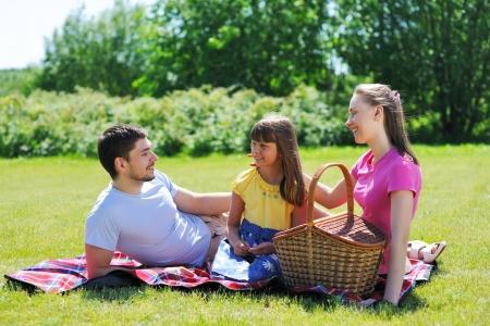 Family on picnic at sunny day Stock Photo - 9736845