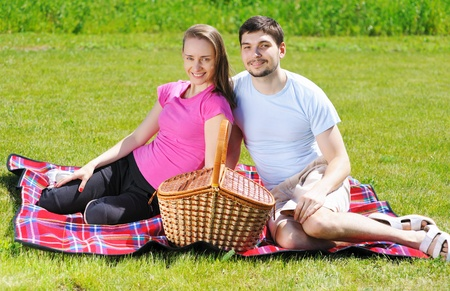 Couple on picnic at sunny day             photo
