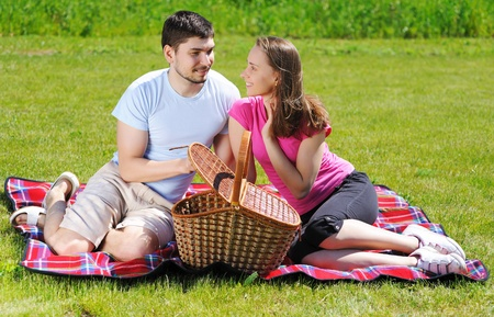 Couple on picnic at sunny day Stock Photo - 9736847