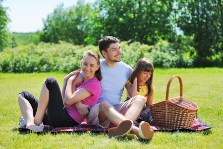 Family on picnic at sunny day photo