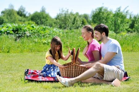 family picnic: Family on picnic at sunny day Stock Photo