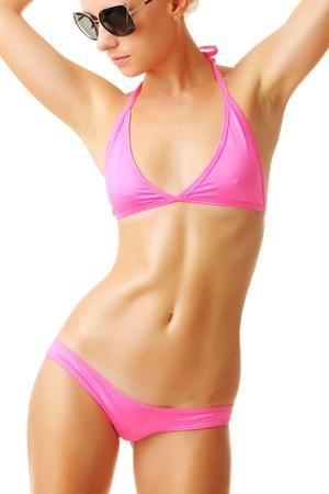 Sexy tan woman in bikini isolated on white background Stock Photo - 10478068