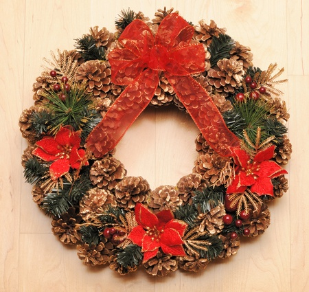 Traditional christmas wreath over wooden background  photo