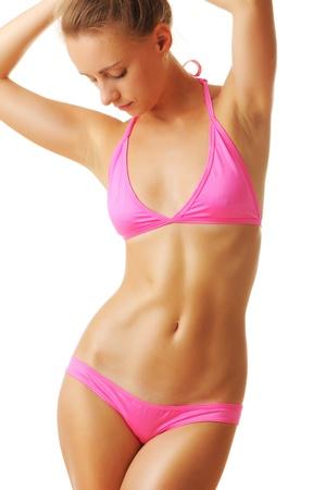 Sexy tan woman in bikini isolated on white background Stock Photo - 10875335