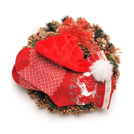 Traditional christmas wreath with santa hat an stocking isolated on white photo