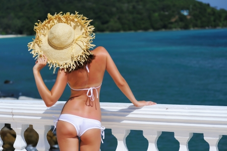 butt: Girl on a tropical resort with hat Stock Photo