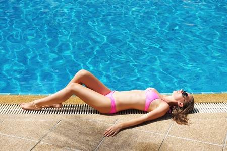 Girl at tropical swimming pool photo