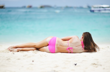 Girl laying on a tropical beach photo
