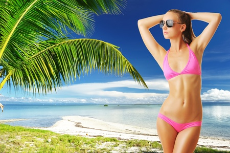 Woman with beautiful body wearing sunglasses at tropical beach. Collage. Stock Photo - 12398700