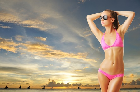 Woman with beautiful body on tropical beach at sunset. Collage. photo