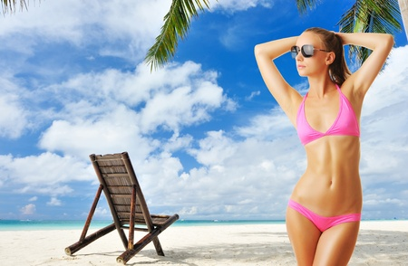 Woman with beautiful body wearing sunglasses at tropical beach. Collage. Stock Photo - 12398686