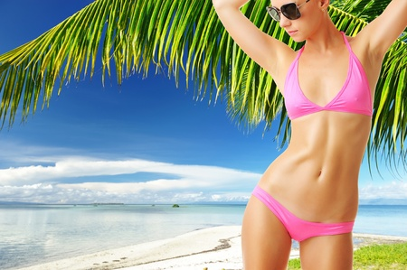 Woman with beautiful body wearing sunglasses at tropical beach. Collage. Stock Photo - 12398693