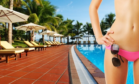 Girl with sunglasses at tropical swimming pool. Collage. Stock Photo - 12398694