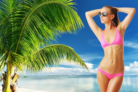 Woman with beautiful body wearing sunglasses at tropical beach. Collage. Stock Photo - 12640202
