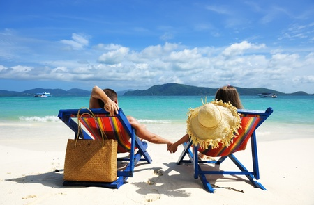 two chairs: Couple on a tropical beach