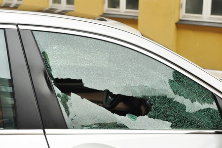 vehicle window: Broken passenger window, car theft Stock Photo