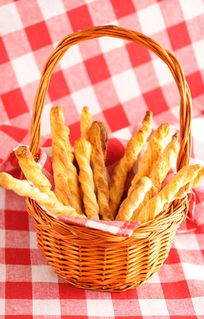 twists: Cheese twists pastry over red cloth
