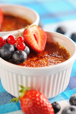 Creme brulee (cream brulee, burnt cream) with fruits and berries Stock Photo - 13509053