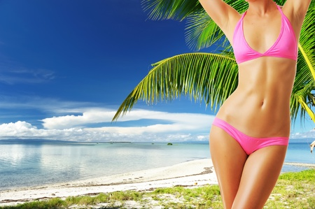 Woman with beautiful body at tropical beach. Collage. photo