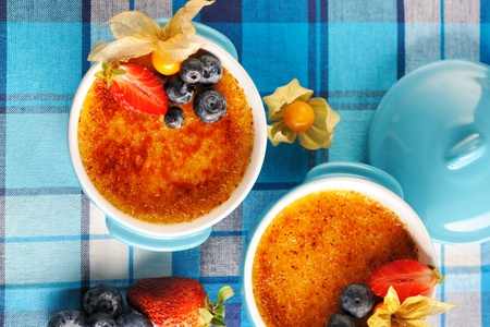 brulee: Creme brulee (cream brulee, burnt cream) with fruits and berries