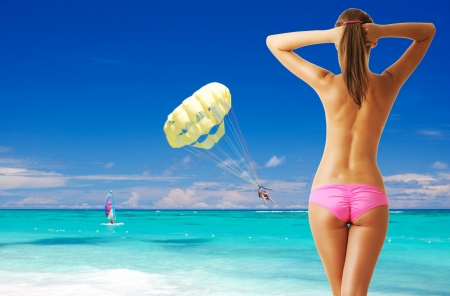 Woman with beautiful body at tropical beach. Collage.