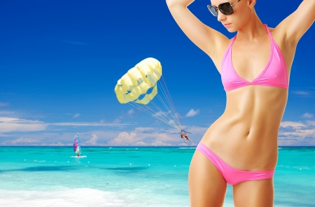 Woman with beautiful body wearing sunglasses at tropical beach. Collage. photo